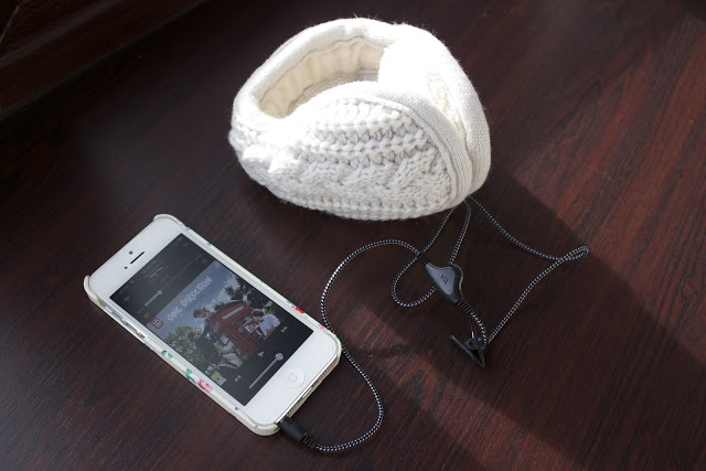 a picture of hear muffs with iphone 5 playing one direction