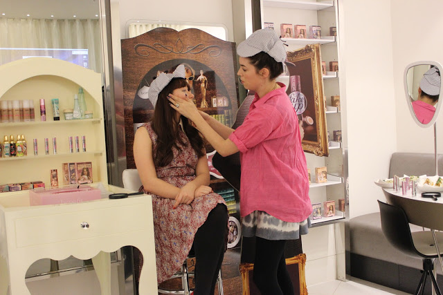 A picture of the benefit fake up event demonstration with Lisa and Rachel