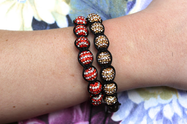 a picture of cutey shamballa bracelet red and gold being worn