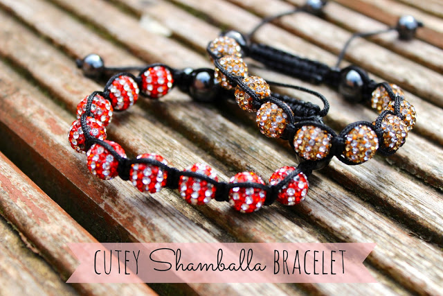 a picture of cutey shamballa bracelet red and gold