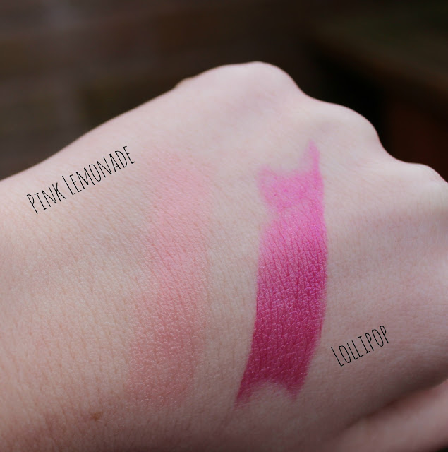 a picture of swatches of the revlon lip butter pink lemonade and lollipop